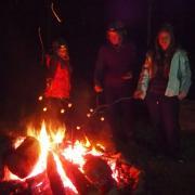 Toasting marshmallows on the bonfire